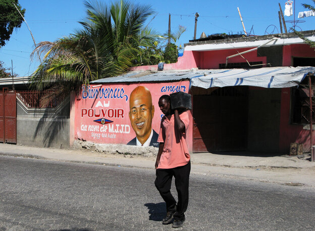 A storefront in Port-au-Prince, Haiti, is brightly painted with a message welcoming President Michel Martelly into power. Two years after a deva