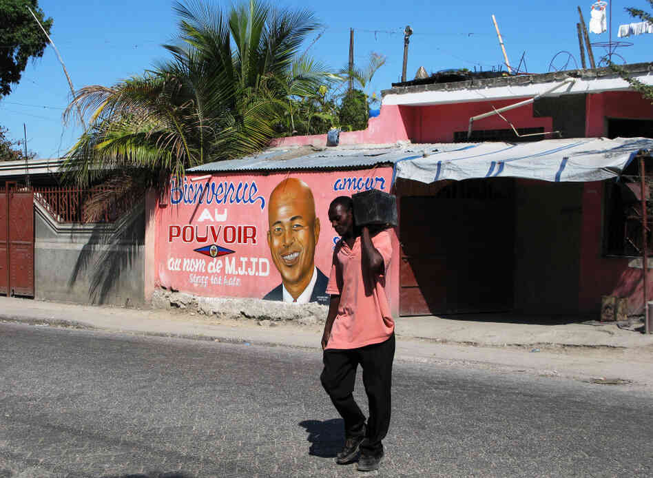 A storefront in Port-au-Prince, Haiti, is brightly painted with a message welcoming President Michel Martelly into power. Two years after a devastating earthquake destroyed much of the Haitian capita