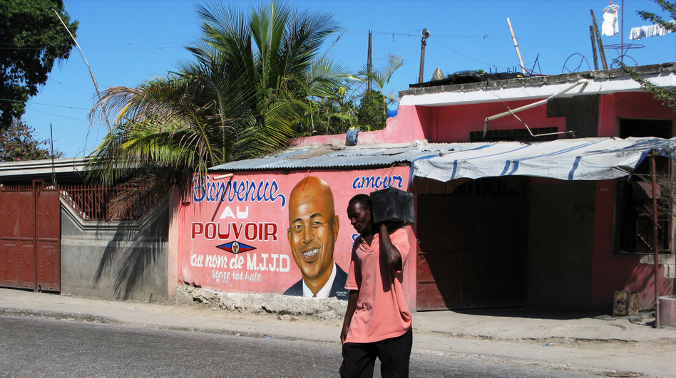 A storefront in Port-au-Prince, Haiti, is brightly painted with a message welcoming President Michel Martelly into power. Two years after a devastating earthquake destroyed much of the Haitian capital, progress is palpable. (NPR)