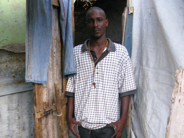 Charles Giiagliard, his wife and his five children live in this one-room shack in downtown Port-au-Prince. The Giiagliards are among half a million people who still live in the squalid tent camps seen all over Haiti's capital.