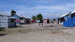 Seventy-three temporary wooden shelters were built last month by the American Red Cross together with other nongovernmental organizations in the Cite Soleil neighborhood of Port-au-Prince. Some residents of the new settlement, Village Carvil, have already added living space with tarps.