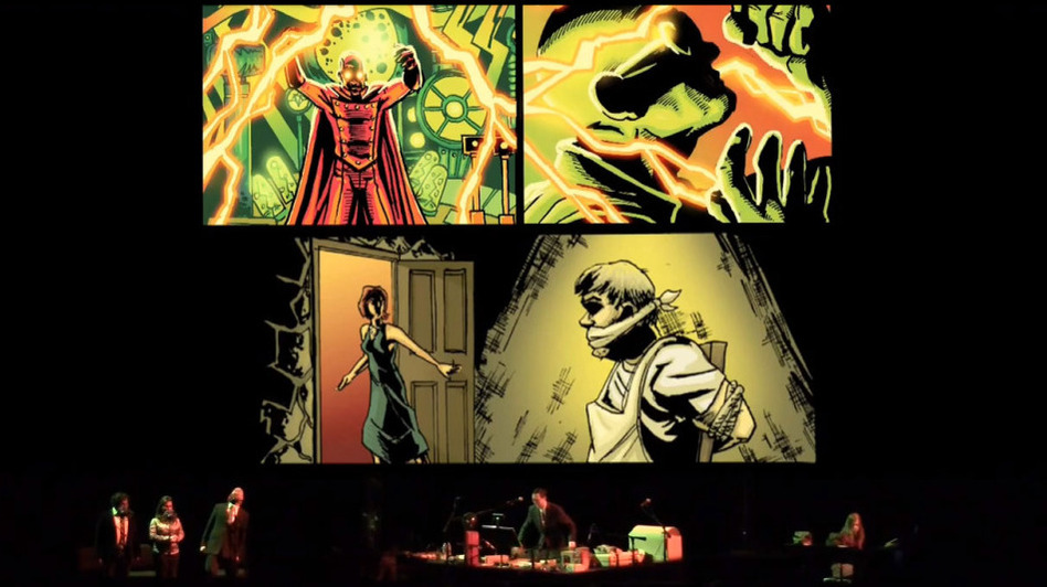 <strong>A Multimedia Production:</strong> The performance of <em>The Intergalactic Nemesis </em>involves (from left to right) three voice actors, a foley artist, a keyboardist and, overhead, art from the graphic novel on screen.