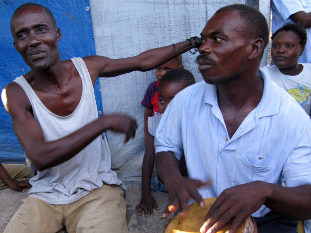 Pierre Jean Nelson (left) has lived at Champs de Mars, a camp for displaced people, since the quake hit.