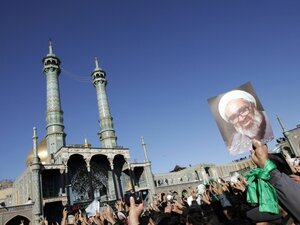 Iranians hold portraits of Grand Ayatollah Hossein Ali Montazeri during his funeral procession in the holy city of Qom on Dec. 21, 2009. The Fodrow uranium enrichment plant is located below Qom.