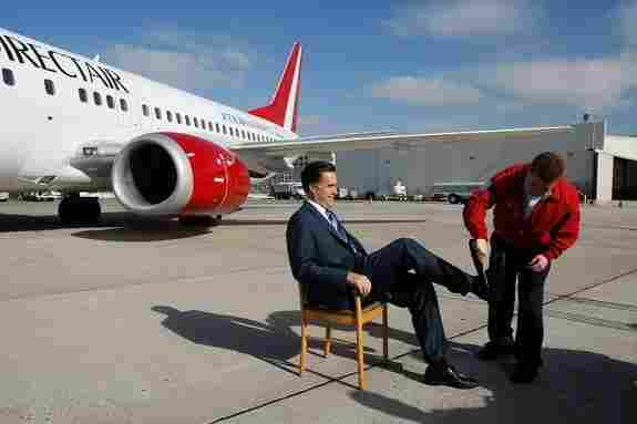 Mitt Romney being screened before boarding a plane at the San Diego airport for Denver, Colo. in February 2008.