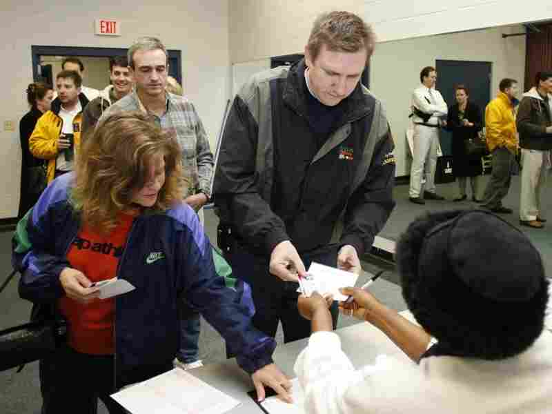 Voters Arlene and Michael Cochran cast their votes in the South Carolina Republican presidential primary at the Jones Recreational Center in Mount Pleasant, S.C., Jan. 19, 2008.