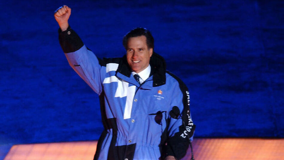 Mitt Romney, then the president of the 2002 Salt Lake Organizing Committee, greets attendees at the opening ceremony of the Winter Olympics in Utah.  (AFP/Getty Images)