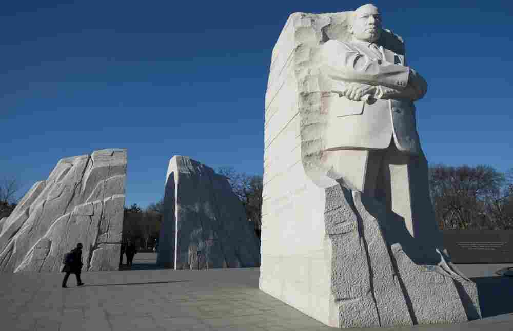 Tourists walk through the Martin Luther King Jr. Memorial honoring the iconic civil rights leader in Washington.