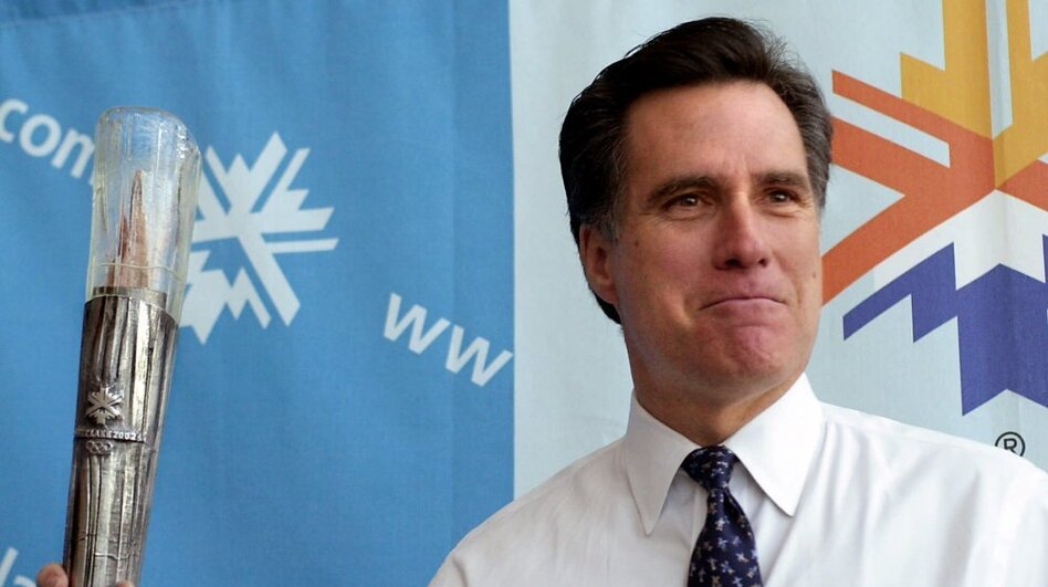 Romney, then-president of the SLOC, holds the planned Olympic torch during a news conference in February 2001 in Salt Lake City.  (AP)
