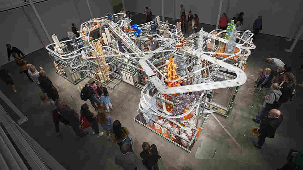 About 1,200 tiny custom-made cars zoom around Metropolis II. If there's an accident, the sculpture comes with nearly 11,000 more toy cars, ready to hit the road.