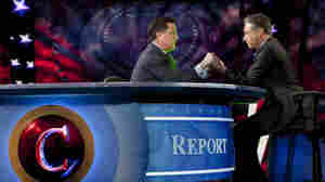 Stephen Colbert, left, and Jon Stewart held hands as they transferred Colbert's Super PAC to Stewart's control.