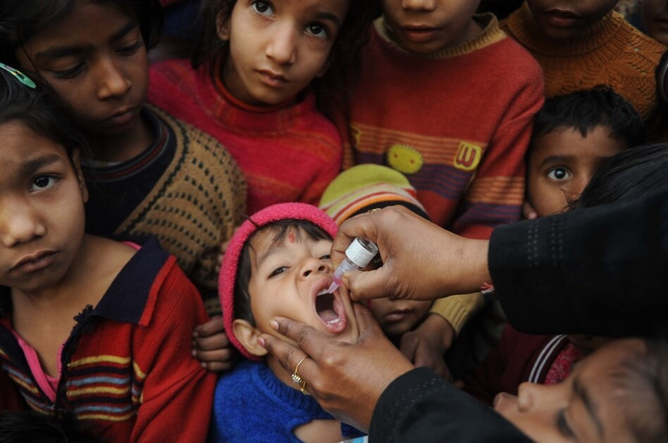 An Indian boy receives a polio vaccination from an Indian health worker in Amritsar last year.