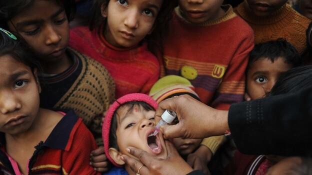 An Indian boy receives a polio vaccination from an Indian health worker in Amritsar last year. (AFP/Getty Images)