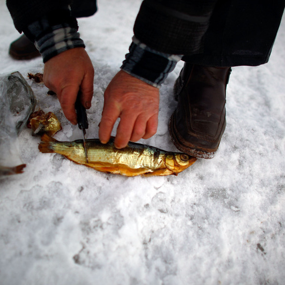 Yuri Bronnikov prepares  cold-smoked Omul, a type of whitefish considered a delicacy in Russia and found only in Lake Baikal.</p