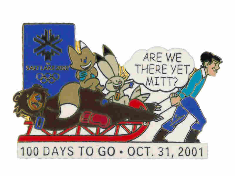 "The ""100 days to go"" pin, with Romney pulling a sled full of mascots."