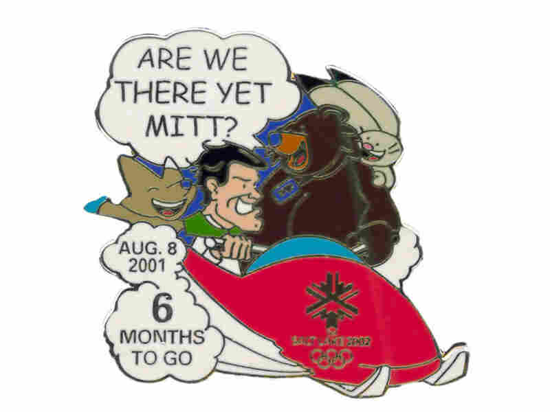 "The ""6 months to go"" pin, with Romney driving a bobsled and the mascots asking, ""Are we there yet?"""