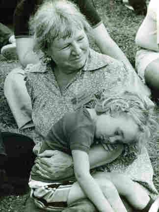 Margaret MacArthur cradles a young Robin.