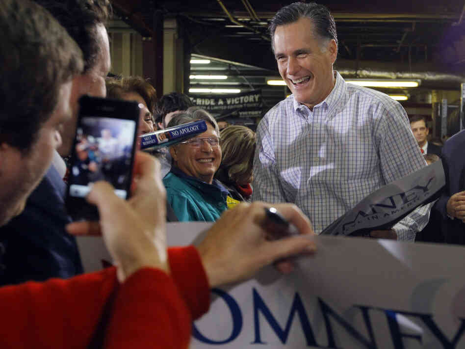 Former Massachusetts Governor Mitt Romney greets supporters during a campaign stop at Cheroke