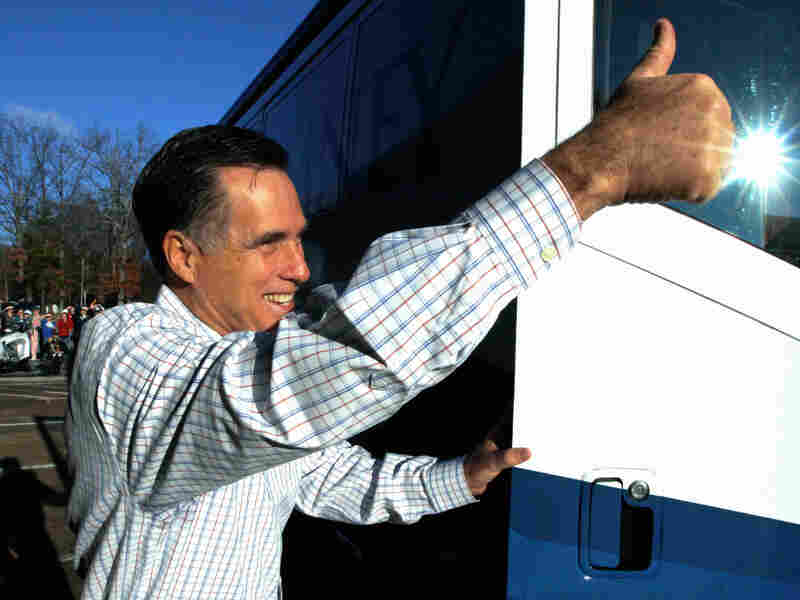 Republican presidential candidate, former Massachusetts Gov. Mitt Romney, gives a thumbs up as he gets back on his campaign bus in South Carolina.