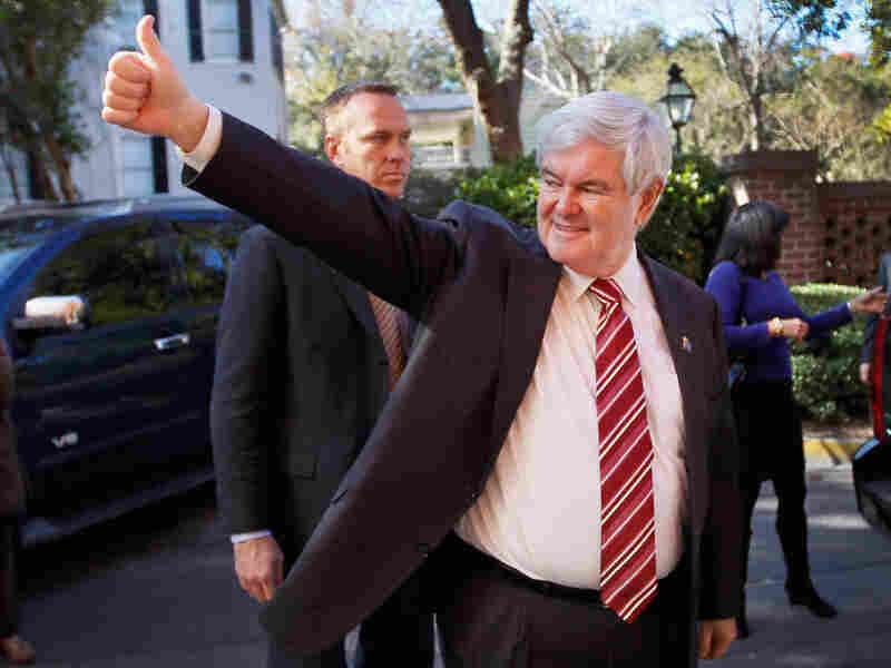 Newt Gingrich arrives for a GOP presidential candidate forum Saturday in South Carolina. Gingrich had to be reminded of the rules not to mention rivals by name, but was still able to continue criticism of Mitt Romney.