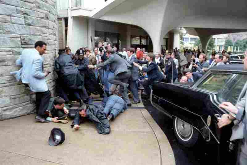 Chaos reigns outside the Washington Hilton Hotel after Reagan was shot during an assassination attempt only 69 days after taking office in 1981.