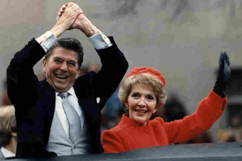 The Reagans wave from the limousine during their first inaugural parade in 1981.