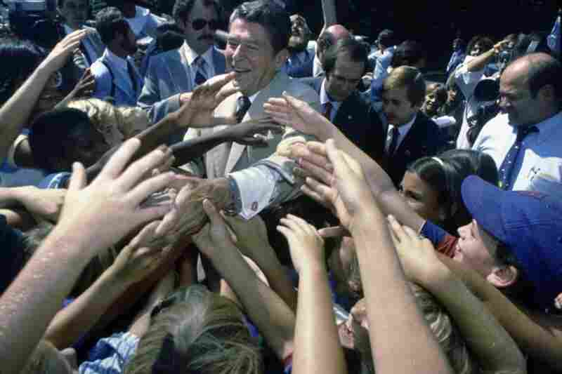 "Ronald Reagan shakes hands with supporters at a 1980 campaign stop in Indiana. Reagan's presidential campaign surged ahead after his October debate with Democrat opponent Jimmy Carter, when he closed his argument with the question: ""Are you better off now than you were four years ago?"""