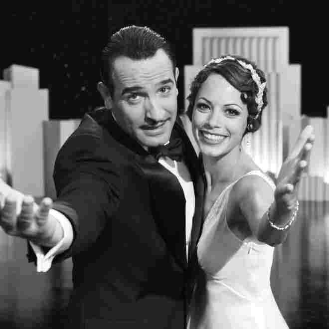 Silent Screen idol George Valentin (Jean Dujardin) and Peppy Miller (Berenice Bejo), a young and upcoming dancer, share a vivacious moment on stage in Michel Hazanavicius's film The Artist.
