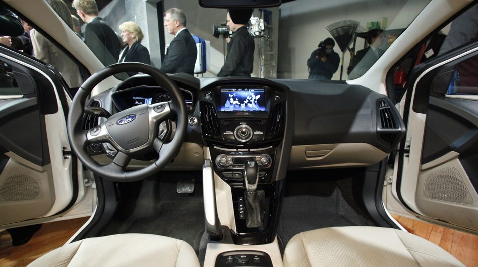 Ford's MyFord Touch interface allows users to manage phone calls, navigation, entertainment and the car's temperature through a touch screen on the dashboard.  (AP)