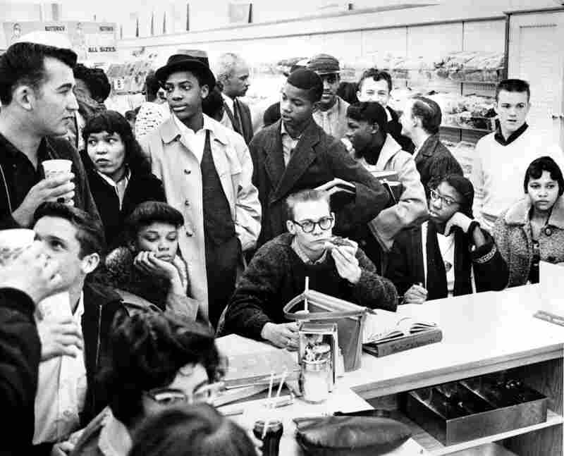 Three African-American girls sit next to a white boy during a sit-in at a lunch counter in Portsmouth, Va., in February 1960. The demonstrators are largely students.