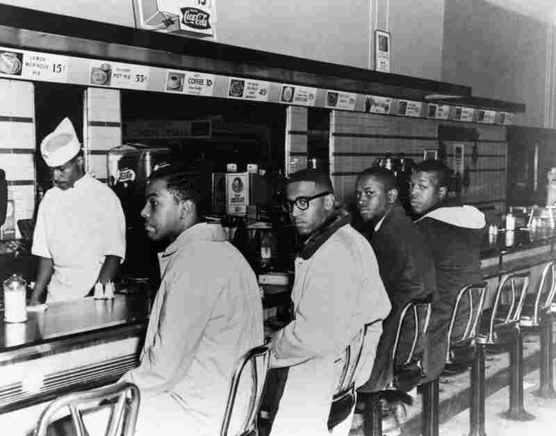 In February 1960, college students (from left) Joseph McNeil, Franklin McCain, Billy Smith and Clarence Henderson began a sit in protest at the whites-only lunch counter at a Woolworth's in Greensboro, N.C. ---