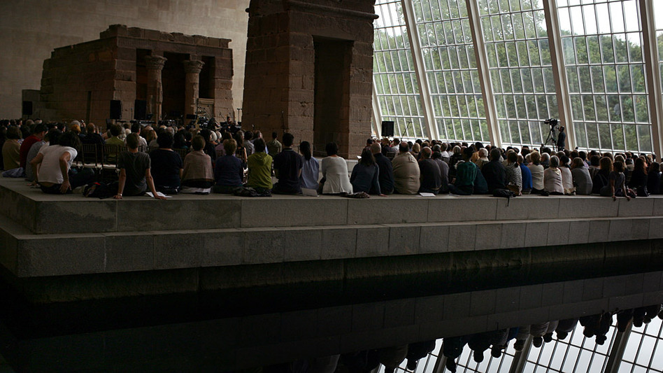 "A view from across the reflecting pool of the ""Remembering September 11"" concert by the Wordless Music Orchestra — conducted by Ryan McAdams, presented at The Temple of Dendur in The Metropolitan Museum of Art in Manhattan on Sept. 11, 2011."