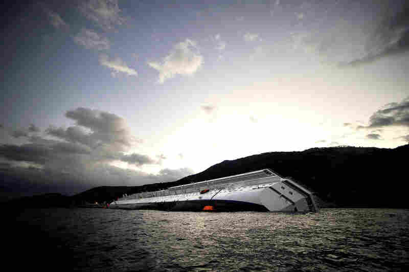 The Costa Concordia lies stranded in the Giglio harbor on Sunday.