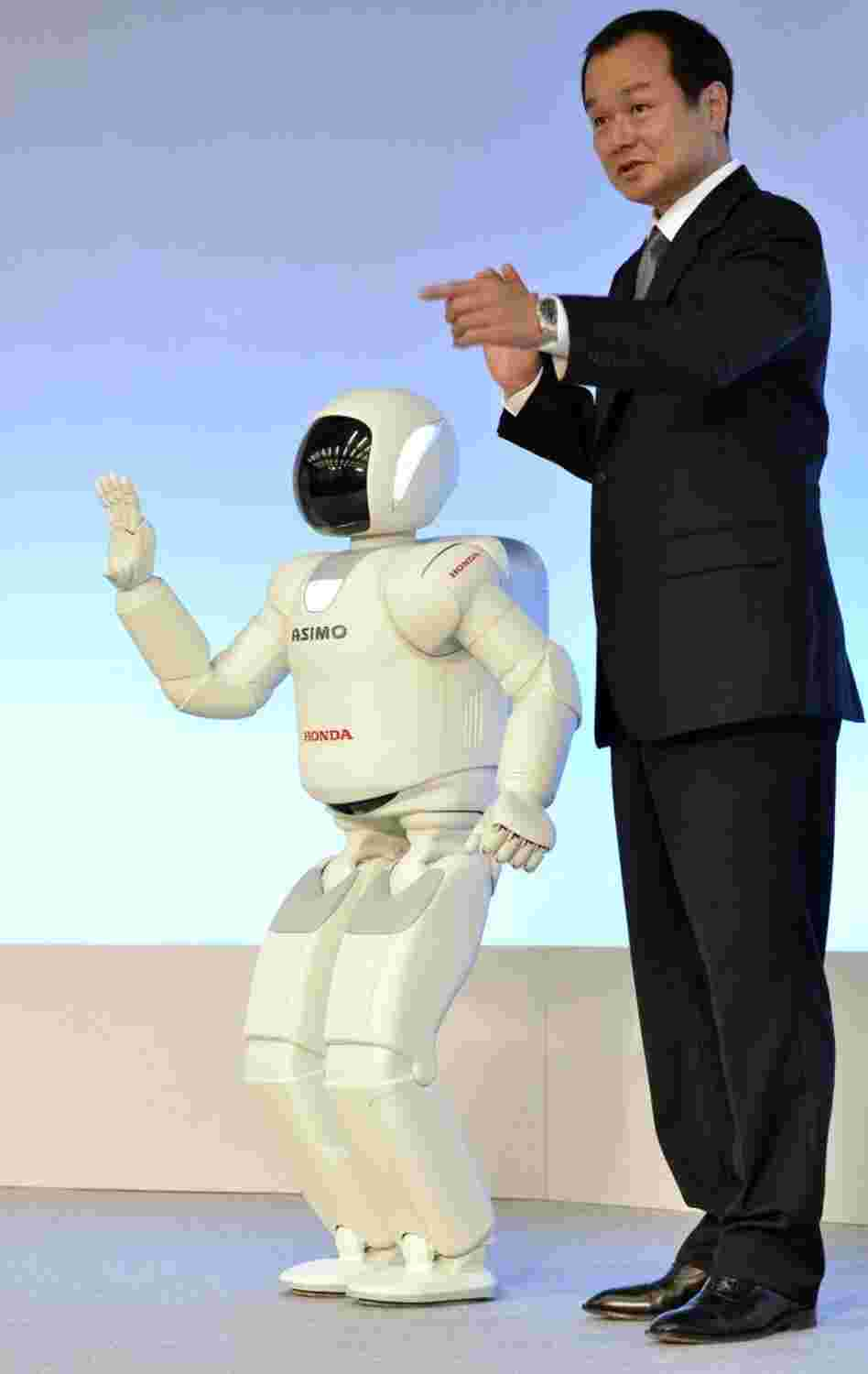 Man and machine stand side-by-side: Honda's Asimo robot.