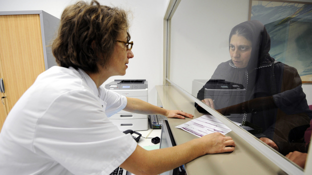 France's 35-hour work week has resulted in some workers accumulating vast amounts of overtime that they are required to use this year. The problem is particularly acute at some hospitals. Here a woman speaks with a doctor at the Conception Hospital in Marseille on Tuesday. (AFP/Getty Images)