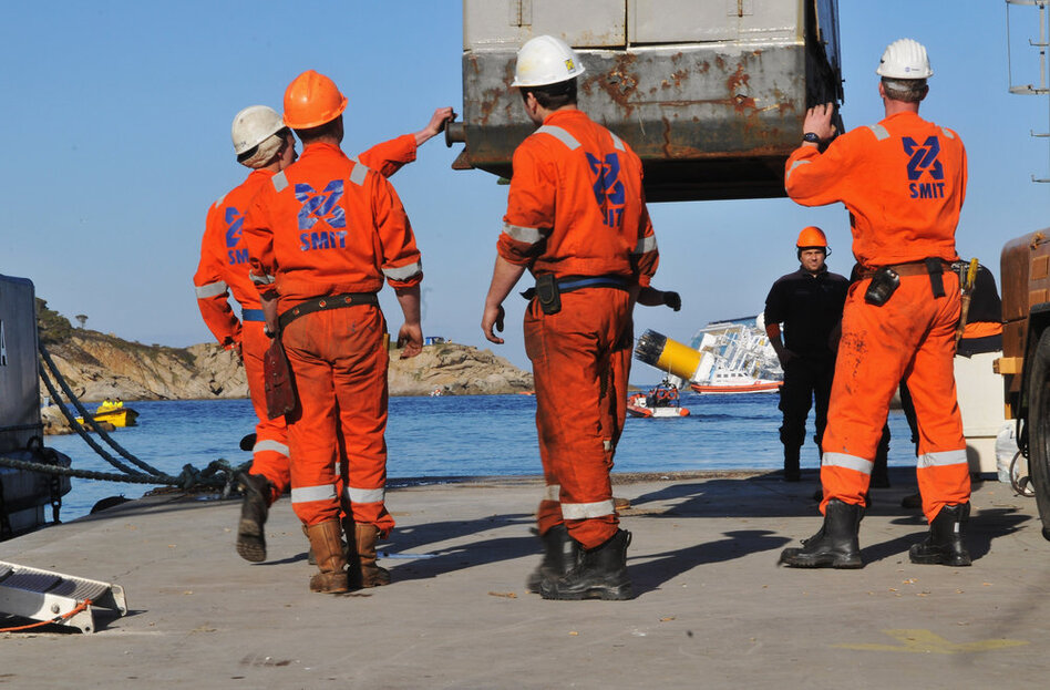Workers prepare to recover fuel from the damaged ship on Wednesday. The ship was carrying about a half-million gallons of fuel. So far, there is no sign that it has leaked.