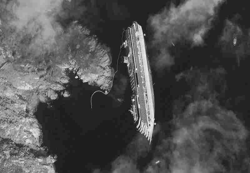 This satellite image taken Tuesday shows the hulk of the luxury ship.