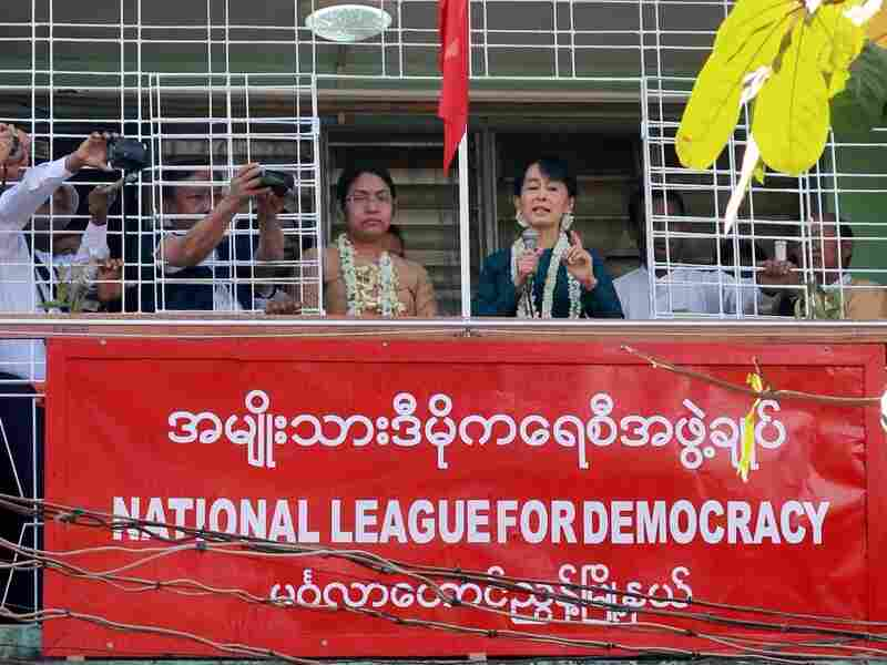 Myanmar democracy icon Aung San Suu Kyi (R) gives a speech to supporters of her National League for Democracy in Yangon, on Jan. 17, 2012. President Thein Sein, a former military officer who was elected in widely considered fraudulent elections, may be a Gorbachev like reformist.