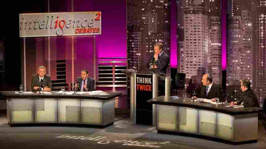 """Mustafa Barghouthi (from left), Daniel Levy, debate moderator John Donvan, Dore Gold and Aaron David Miller speak before an audience in New York on the motion """"The U.N. Should Admit Palestine As A Full Member State."""""""