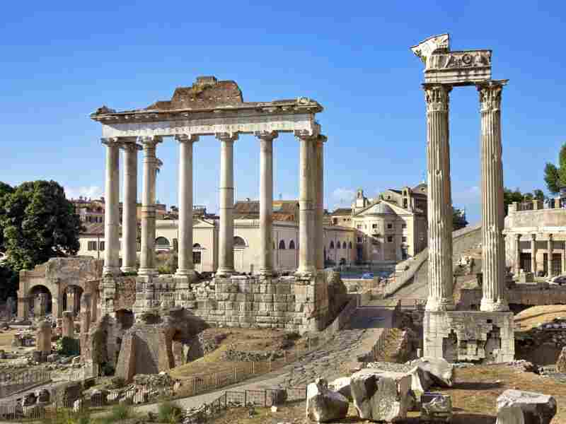 Ancient columns of the Temple of Saturn in the Roman Forum in Rome. Historians have noted that the Roman Empire expanded beyond its abilities to defend its borders.
