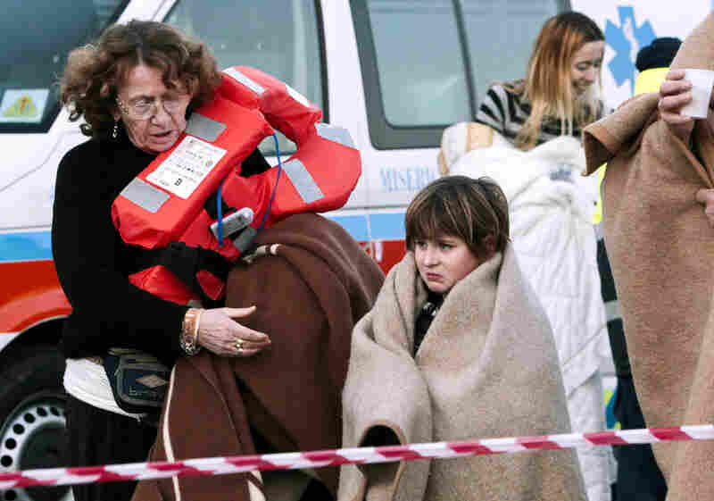 Passengers disembark at a ferry in Porto Santo Stefano, Italy, on Saturday.