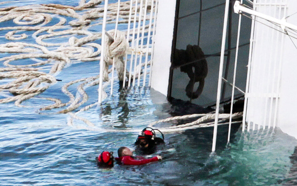 Rescuers exploded four holes in the hull of the ship to gain easier access to areas that had not yet been searched. Here, a scuba diver recovers a body Tuesday.