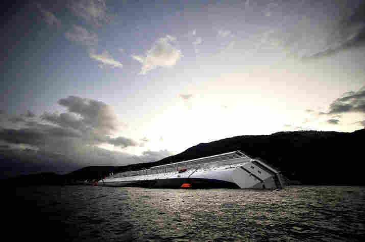 The Costa Concordia lies stranded in the Giglio harbor on Tuesday.