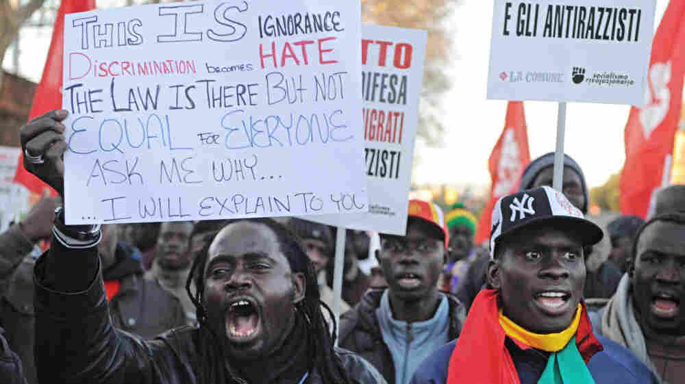 Immigrants from Senegal protest against racism in Florence, Italy, on Dec. 17, 2011. Four days earlier, an Italian man killed two African street sellers and wounded three others in a shooting spree in Florence.