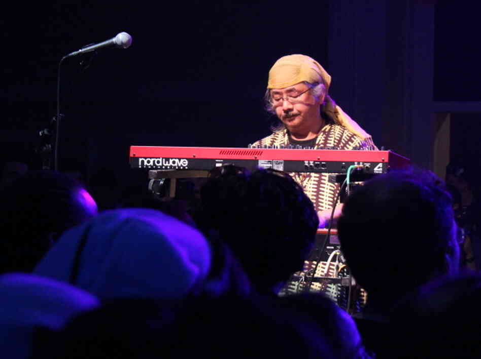 Nobuo Uematsu plays keyboard with Earthbound Papas, a rock band made up of video-game soundtrack composers.