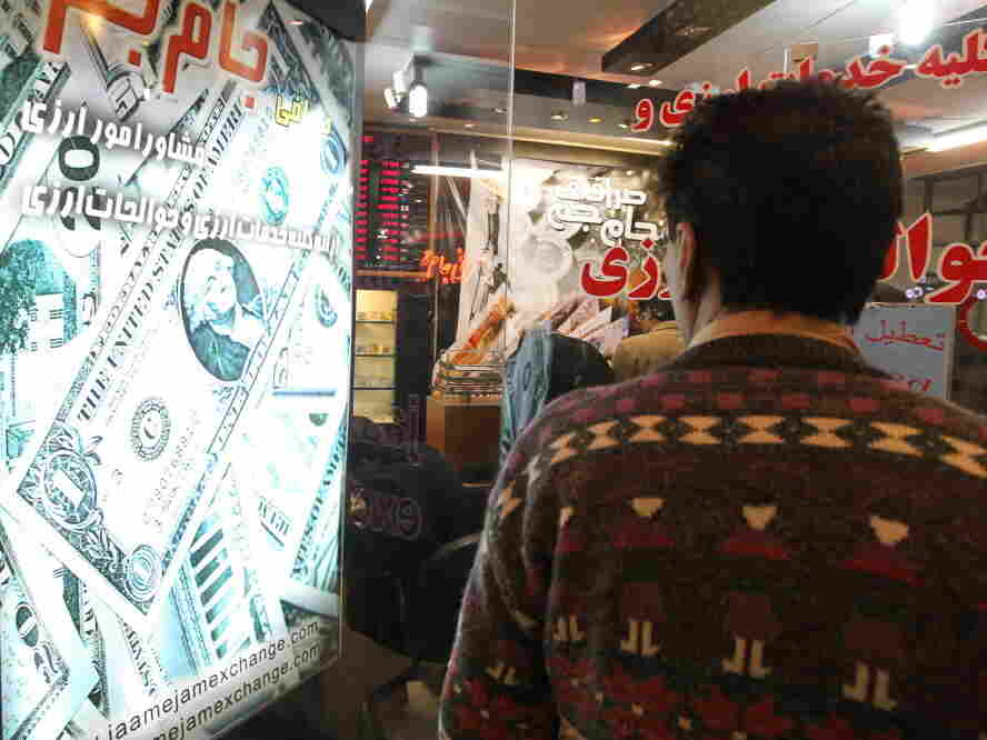 A man looks at the rates outside a currency exchange in a shopping center in Tehran.