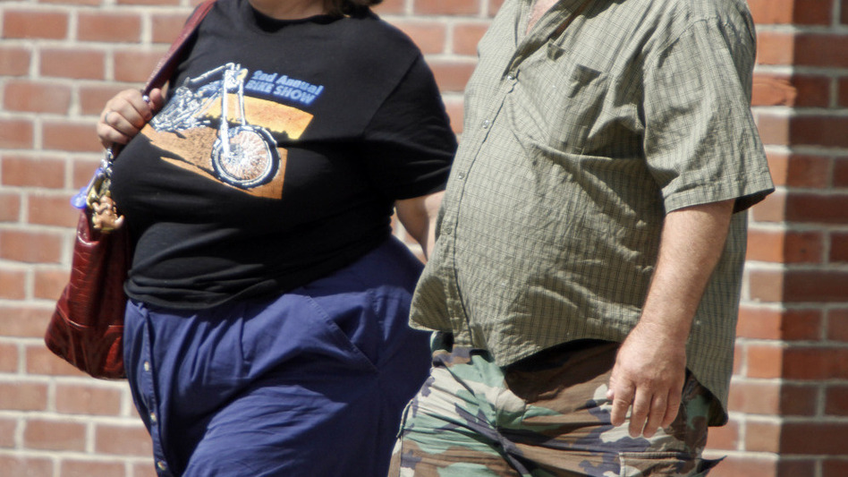 "People stroll down a street in Montpelier, Vt., last summer. In 1995, 13.4 percent of Vermonters were considered obese. The figure climbed to <a href=""http://healthyamericans.org/reports/obesity2011/release.php?stateid=VT"">23.5 percent in 2011</a>. The latest national data suggest the obesity epidemic has plateaued, however. (Toby Talbot/AP)"