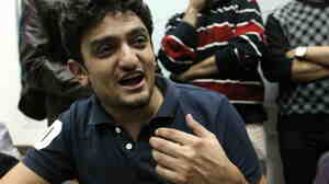 Wael Ghonim talking with reporters on Feb. 8, 2011, in Cairo's Tahrir Square as protests there continued.