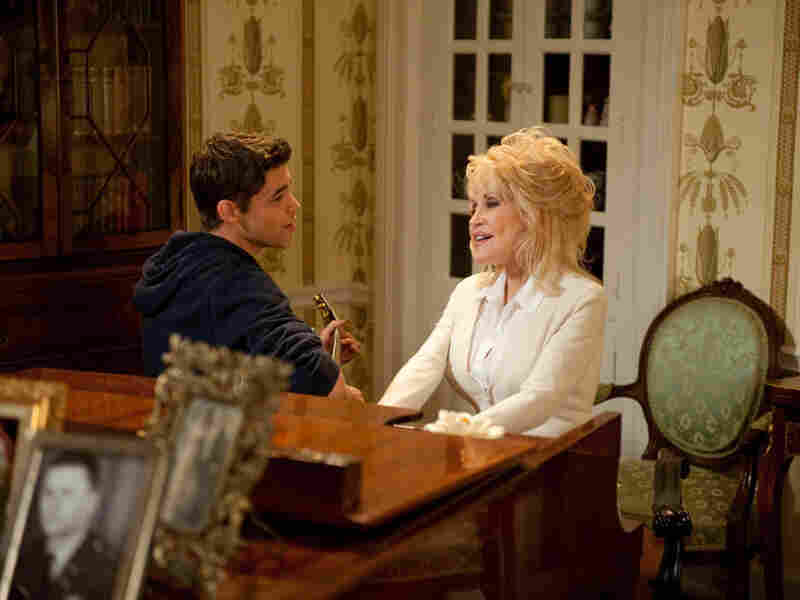 """Dolly Parton and Jeremy Jordan sing """"From Here to the Moon and Back,"""" written by Parton."""