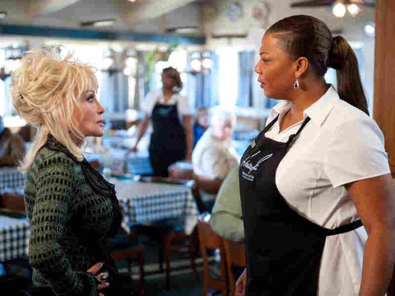 G.G. Sparrow (Dolly Parton) and Vi Rose Hill (Queen Latifah) clash in the new film Joyful Noise.